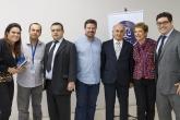 O Professor Marcus Seixas (ao centro) ladeado por professores em evento do curso de Direito