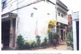 O mesmo muro em Acari antes exibia imagem de santa católica (2001) - Reprodução
