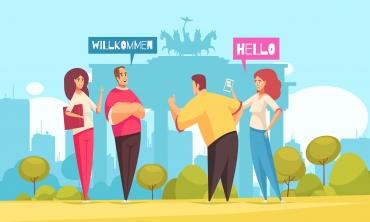 """Desenho de quatro pessoas, dois homens e duas mulheres conversando em um parque com balões com as palavras """"hello"""" e """"willkommen"""""""